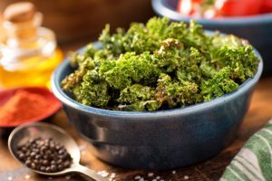 A bowl of crispy delicious baked kale chips. ** Note: Shallow depth of field